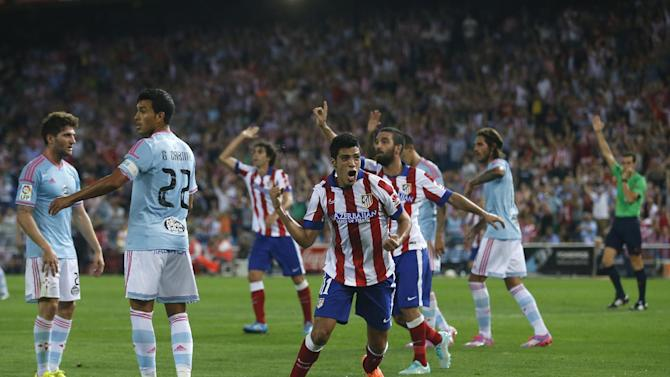 Atletico's Raul Jimenez, centre, reacts, as referee, right, disallows his goal during a Spanish La Liga soccer match between Celta and Atletico Madrid at the Vicente Calderon stadium in Madrid, Spain, Saturday, Sept. 20, 2014
