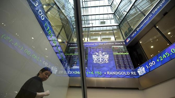Electronic information boards display market information at the London Stock Exchange in the City of London