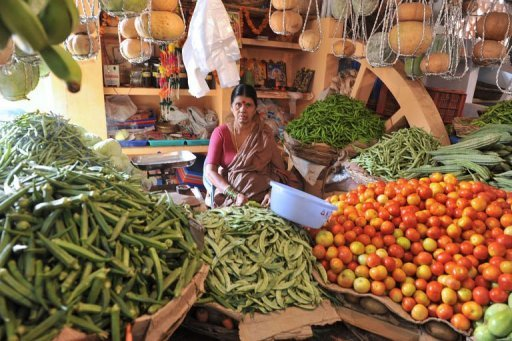 <p>File phtoo shows an Indian vendor at a vegetable market in Hyderabad. India is set to announce dismal new economic growth figures on August 31, 2012, with expansion in the April-June quarter forecast at near nine-year-lows.</p>