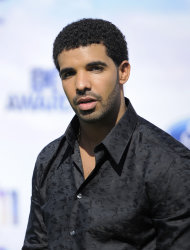 "FILE - In this June 26, 2011 file photo, Drake arrives at the BET Awards in Los Angeles. A day after earning his high school diploma, an excited Drake performed hit songs for a few hundred people at an event for Tyra Banks. The 25-year-old told the crowd Thursday, Oct. 18, 2012, that he took a small break from music and ""spent some time going back to high school."" He dropped out of high school, ironically, to star in the high school TV series ""Degrassi: The Next Generation."" (AP Photo/Chris Pizzello, file)"