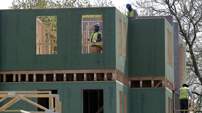 FILE - In this Wednesday, April 24, 2013 file photo, workers are seen at the construction site of a new housing complex, in Trenton, N.J. A Federal Reserve survey says economic growth increased throughout the United States from April through mid-May, fueled by home construction, consumer spending and steady hiring. (AP Photo/Mel Evans, File)