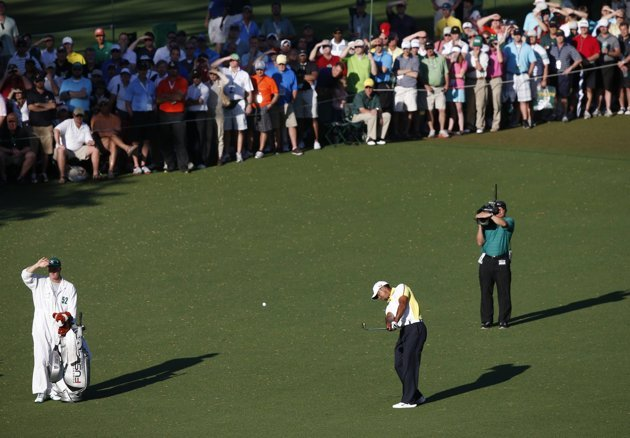 Woods of the U.S. hits his second chip shot to the 15th green during second round play in the 2013 Masters golf tournament in Augusta