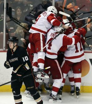 Detroit Red Wings players celebrate Gustav Nyquist's goal during overtime as Anaheim Ducks' Corey Perry (10) skates off in Game 2 of their first-round NHL hockey Stanley Cup playoff series in Anaheim, Calif., Thursday, May 2, 2013. The Red Wings won 5-4. (AP Photo/Chris Carlson)