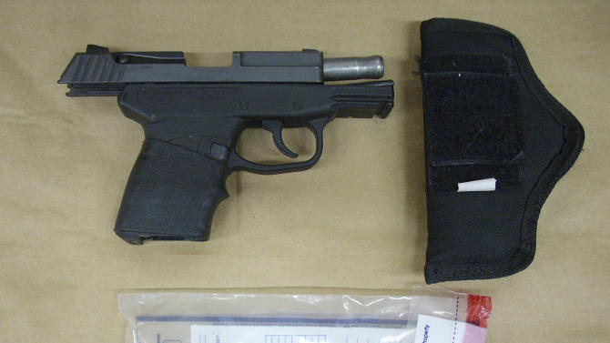 This Feb. 27, 2012 photo released by the State Attorney's Office shows the Kel-Tec PF-9 9mm handgun used by George Zimmerman, the neighborhood watch volunteer who shot Trayvon Martin. The photo and reports were among evidence released by prosecutors that also includes calls to police, video and numerous other documents. The package was received by defense lawyers earlier this week and released to the media on Thursday, May 17, 2012. (AP Photo/State Attorney's Office)