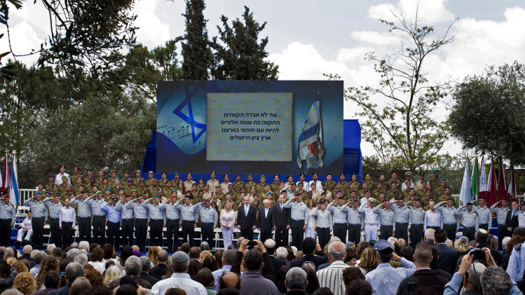 Israeli Prime Minister Benjamin Netanyahu, center left, Israeli President Shimon Peres, center, and Israeli military's chief of staff Lt. Gen. Benny Gantz, center right, attend Israel's Independence Day celebration at the President's residence in Jerusalem, Israel, Tuesday, April 16, 2013. Israel is celebrating 65 years of independence with barbeques, air force flyovers, and a bible quiz. (AP Photo/Llia Yefimovich, Pool)