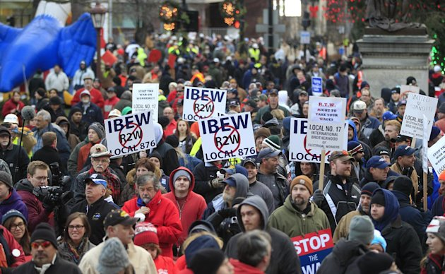 Thousands of protesters gather for a rally on the State Capitol grounds in Lansing, Mich., Tuesday, Dec. 11, 2012. The crowd is protesting right-to-work legislation that was passed by the state legisl