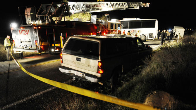 Authorities continue their investigation at the scene where at least eight people were killed and 38 people were injured after a tour bus carrying a group from Tijuana, Mexico crashed with two other vehicles just north of Yucaipa, Calif., Sunday, Feb. 3, 2013. (AP Photos/Rodrigo Pena)