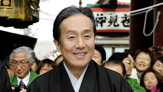 In this photo taken Nov. 27, 2011, Kabuki actor Kanzaburo Nakamura pauses before a parade in Tokyo to celebrate promotion of his son in Kabuki rank. Kanzaburo, who helped boost the popularity of the traditional Japanese art form, died Wednesday, Dec. 5, 2012. He was 57. (AP Photo/Kyodo News) NO ARCHIVE, ONE TIME USE ONLY, JAPAN OUT, MANDATORY CREDIT, NO LICENSING IN CHINA, FRANCE, HONG KONG, JAPAN AND SOUTH KOREA