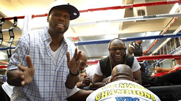 50 Cent at a media workout with Manny Pacquiao's main rival Floyd Mayweather Jr. (Reuters)