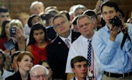 "Supporters listen to Republican presidential candidate, former Massachusetts Gov. Mitt Romney (R) speak during a campaign stop on August 12, 2012 in High Point, North Carolina. Romney attacked Obama as making the United States ""more and more like Europe,"" with its ""chronic high unemployment, low wage growth and fiscal calamity right at the door."""