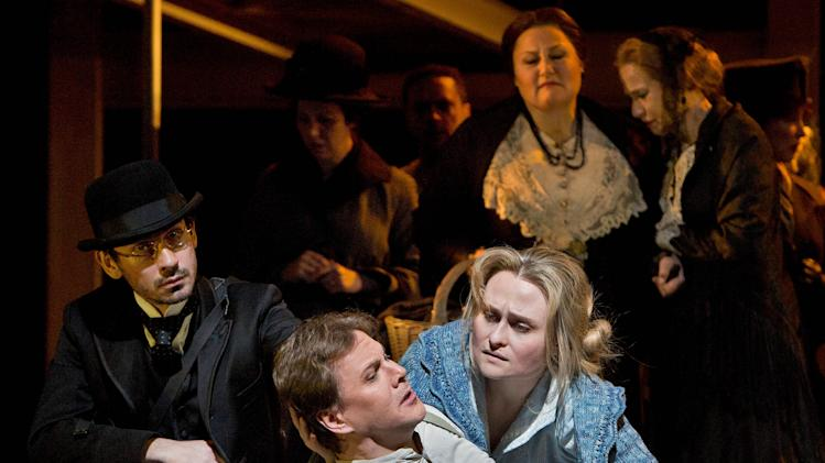 "In this March 18, 2013 photo provided by the Metropolitan Opera, Alexey Markov is Valentin, center left, and Marina Poplavskaya is Marguerite, center right, during a dress rehearsal of ""Faust"" at the Metropolitan Opera in New York. (AP Photo/Metropolitan Opera, Cory Weaver)"