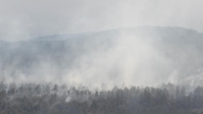 A backburn operation on the northern end of the Whitewater-Baldy fire sends up smoke miles from Reserve, N.M., on Thursday, May 31, 2012. The fire has charred more than 190,000 acres to become the largest in New Mexico's recorded history. (AP Photo/Susan Montoya Bryan)