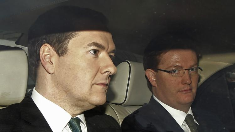 Britain's Chanceller of the Exchequer George Osborne and Chief Secretary to the Treasury Danny Alexander drive to Parliament to present the autumn statement in London
