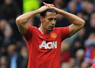 Manchester United's English defender Rio Ferdinand reacts during the English Premier League football match between Manchester United and Everton at Old Trafford in Manchester. Manchester City made the most of Manchester United dropping points against Everton on Sunday to move within three points of the Premier League leaders by beating Wolves