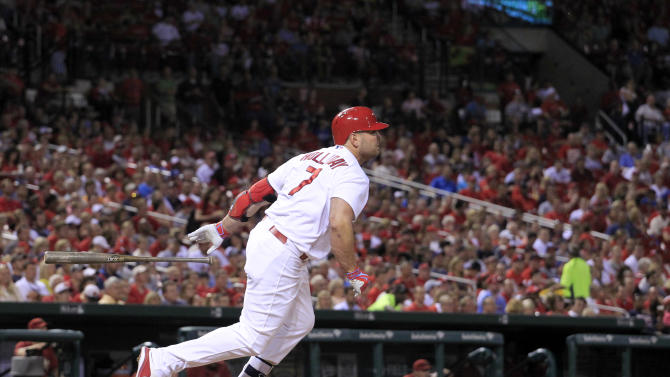 St. Louis Cardinals' Matt Holliday follows through on a single during the fifth inning of a baseball game against the Arizona Diamondbacks Wednesday, May 27, 2015, in St. Louis. With the single, Holliday has reached base in 43 straight games to start the season, setting a franchise record. (AP Photo/Jeff Roberson)