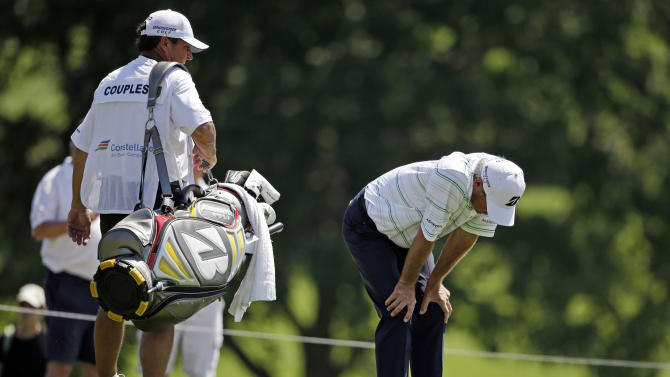 Fred Couples, right, waits to putt on the eighth green during the third round of the Senior Players Championship golf tournament at Fox Chapel Golf Club in Pittsburgh, Saturday, June 29, 2013. Couples is the leader after 54 holes at 15-under par. (AP Photo/Gene J. Puskar)