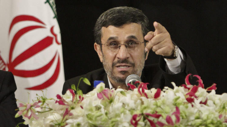 Iranian President Mahmoud Ahmadinejad fieldsa question during a press conference in New York after addressing the 67th session of the United Nations General Assembly on Wednesday, Sept. 26, 2012.  (AP Photo/Bebeto Matthews)