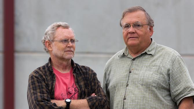 """Ralph Hutchison, left, and Erik Johnson of the Oak Ridge Environmental Peace Alliance stand in front the Blount County jail in Maryville, Tenn., on Friday, Aug. 17, 2012, after meeting with one of three protesters arrested for intruding into Y-12 National Security Complex. Hutchison said the heavy charges against the three protesters, including an 82-year-old nun, reflect a high level of """"embarrassment"""" about the incursion. (AP Photo/Erik Schelzig)"""