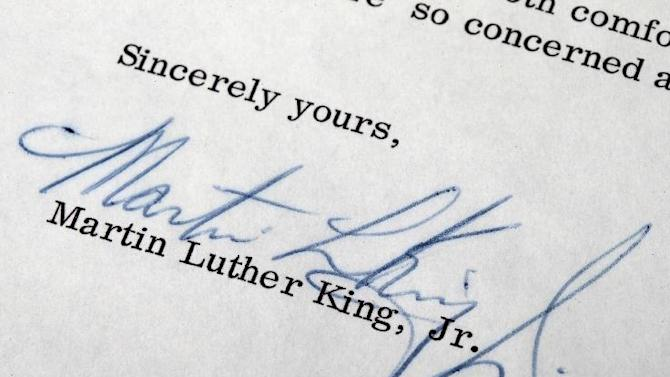Marin Luther King's signature is on a 1965 one-page typewritten letter  Wednesday, April 3, 2013, near Philadelphia.  The Raab Collection, a dealer of rare historic documents is selling the letter from Martin Luther King Jr. to Philadelphia police officer Sgt. James Adair who was assigned to protect him, expressing gratitude for the officer's concerns and minimizing his own worries for his personal safety.  (AP Photo/Matt Rourke)