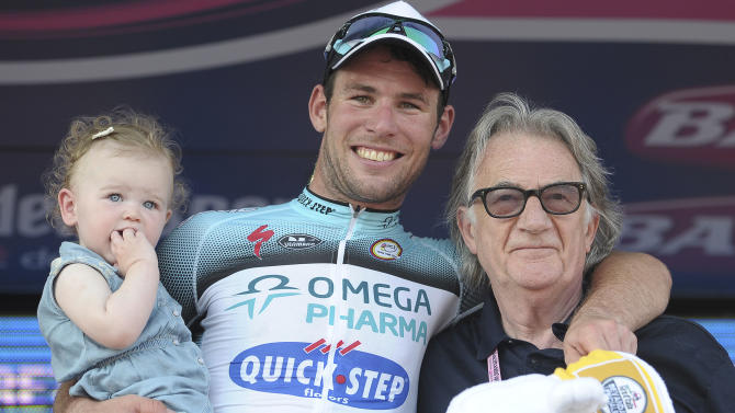 British standout Mark Cavendish, holding his daughter Delilah, celebrates on podium with British designer Paul Smith after winning the opening stage of the Giro d'Italia in a sprint in Naples, Italy, Saturday, May 4, 2013. Cavendish, who rides for the Omega Pharma-Quick Step team, finished in 2 hours, 58 minutes, 38 seconds on the circuit in downtown Naples, which featured a long, flat finishing straight. Cavendish has now won a combined 37 stages at the Giro, Tour and Vuelta — cycling's three Grand Tours. (AP Photo/Fabio Ferrari)