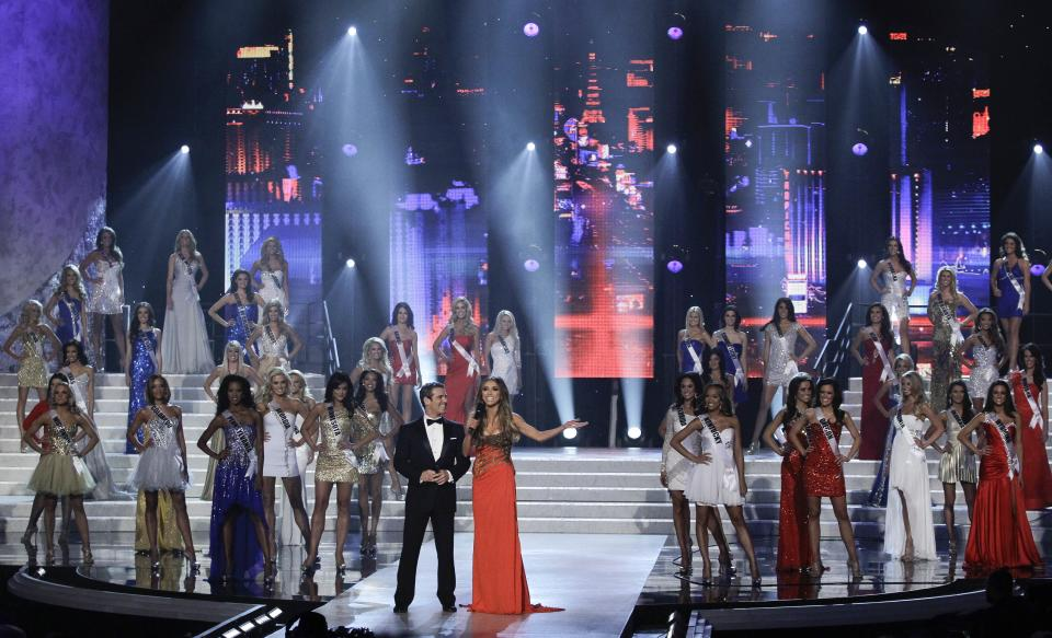 Miss USA hosts Andy Cohen, left, and Giuliana Rancic introduce the contestants in the Miss USA 2011 pageant, Sunday, June 19, 2011, in Las Vegas.  (AP Photo/Julie Jacobson)