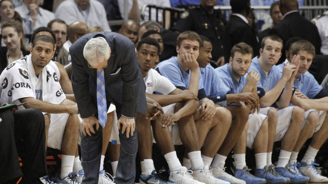 North Carolina coach Roy Williams  reacts during play against the Florida State during the first half of an NCAA college basketball game in the final of the Atlantic Coast Conference men's tournament Sunday, March 11, 2012, in Atlanta. (AP Photo/Chuck Burton)
