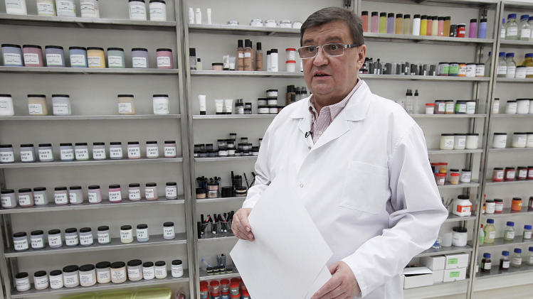 In this Feb. 14, 2013 photo, Wojciech Inglot, late founder and president of the Polish cosmetics company Inglot, stands in a room containing ingredients for his cosmetics in Przemysl, Poland. Inglot and some Muslims say the company's O2M breathable nail polish is the first of its kind because it lets air and moisture pass through to the nail. A craze has built up around it with Muslim women in recent months after an Islamic scholar in the United States tested its permeability and published an article saying that, in his view, it complies with Muslim law.  (AP Photo/Czarek Sokolowski)