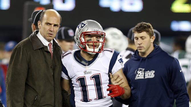 New England Patriots' Julian Edelman (11) is helped off the field during the second half of an NFL football game against the New York Jets, Thursday, Nov. 22, 2012, in East Rutherford, N.J. (AP Photo/Julio Cortez)