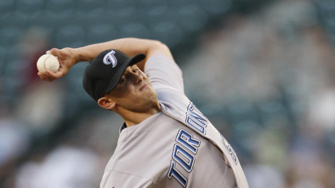 Toronto Blue Jays' pitcher Brad Mills throws in the second inning against the Seattle Mariners during a baseball game in Seattle, on Tuesday, Aug. 16, 2011. (AP Photo/Kevin P. Casey)