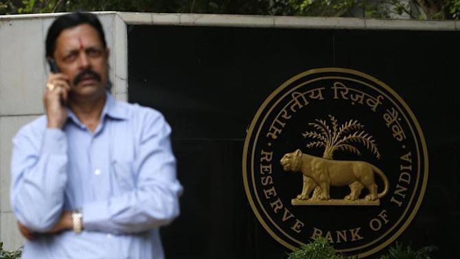 A man speaks on his mobile phone in front of the Reserve Bank of India in Mumbai