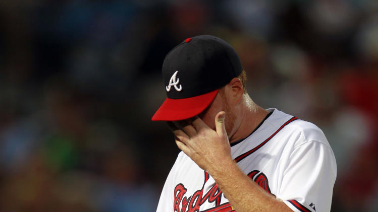 Atlanta Braves starting pitcher Tommy Hanson (48) walks off the field after being relieved in the fourth inning of a baseball game against the Philadelphia Phillies in Atlanta, Wednesday, May 2, 2012. Hanson allowed four runs on eight hits. (AP Photo/John Bazemore)