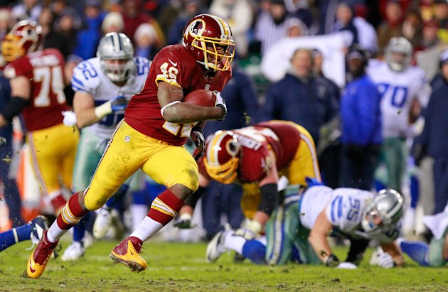 Washington Redskins running back Alfred Morris (46) carries the ball past Dallas Cowboys outside linebacker Alex Albright (55) to score a touchdown in the fourth quarter at FedEx Field. The Redskins won 28-18