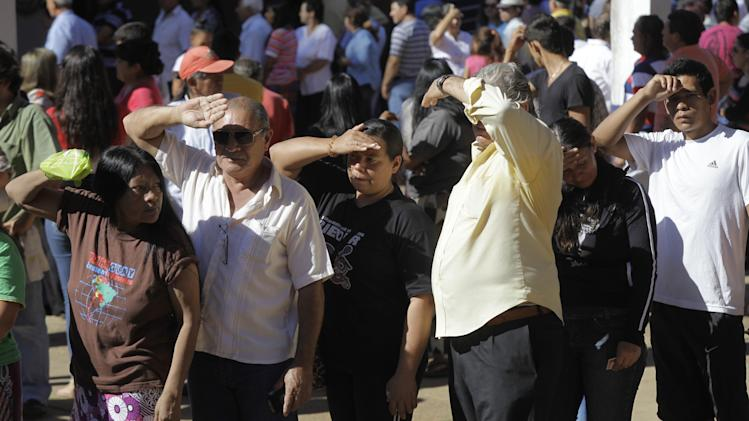 Residents line up to vote during general elections on the outskirts of Asuncion, Paraguay, Sunday, April 21, 2013. The elections are an important milestone in Paraguay's attempt to regain the international acceptance it lost when neighboring nations objected to the fast-track removal of President Fernando Lugo. (AP Photo/Jorge Saenz)