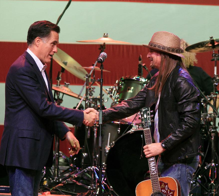 Republican presidential candidate, former Massachusetts Gov. Mitt Romney, shakes hands with Kid Rock at a campaign event at the Royal Oak Music Theatre in Royal Oak, Mich., Monday, Feb. 27, 2012. (AP Photo/Carlos Osorio)