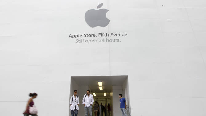 In this Aug. 25, 2011 photo, customers stand outside the Apple flagship store on Fifth Ave., in New York. Apple fans are amped. The computer and gadget maker is expected to announce a new, more powerful version of its wildly popular smartphone this week, more than a year after it unveiled the iPhone 4.  (AP Photo/Richard Drew)