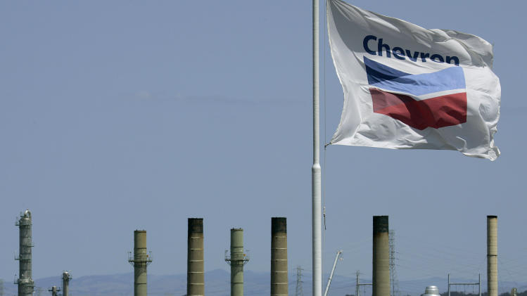 FILE - This April 21, 2008 file photo shows a Chevron flag flying over the Chevron refinery in Richmond, Calif. Chevron Corp. reports quarterly financial results before the market opens on Friday, April 26, 2013. (AP Photo/Ben Margot, File)