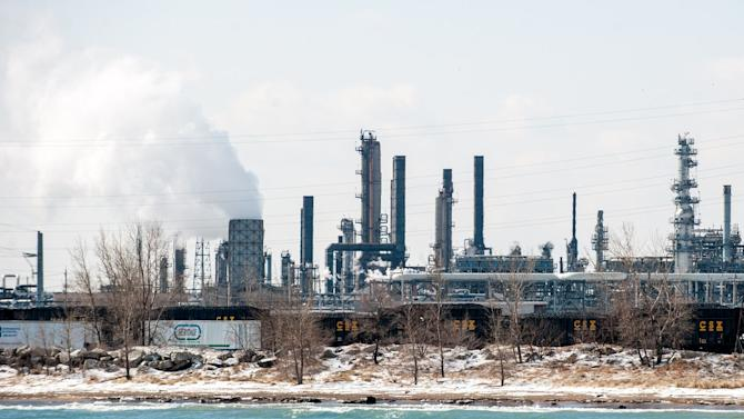 BP's Whiting Refinery is seen along the shore of Lake Michigan on Tuesday, March 25, 2014, in Whiting, Ind. BP says it is assessing how much crude oil entered Lake Michigan following a malfunction at its northwestern Indiana refinery. (AP Photo/The Times, Kyle Telechan) MANDATORY CREDIT; CHICAGO LOCALS OUT; GARY OUT MBO (REV-SHARE)