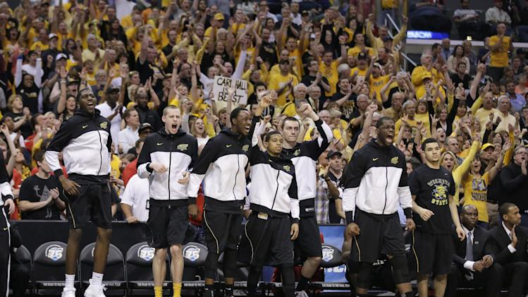 Wichita State players react to a field goal scored against Ohio State during the second half of the West Regional final in the NCAA men's college basketball tournament, Saturday, March 30, 2013, in Los Angeles. (AP Photo/Jae C. Hong)