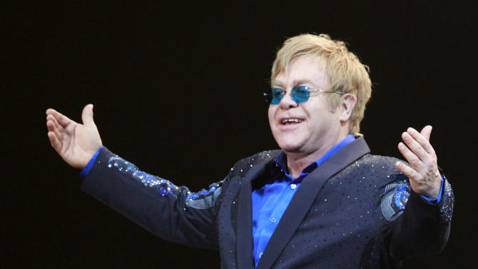 "FILE- In this Friday, Nov. 23, 2012, file photo, Elton John greets the audience during his concert at the Mercedes-Benz Arena in Shanghai, China. The Luddite label has been applied to everyone from anti-technology extremists to those who merely struggle with technology or don't want to bother with it to extremists. ""I'm a Luddite,'' pop star Elton John told the Britain's The Telegraph newspaper in 2011. ""I don't have a phone. I don't have a computer. I don't have an iPad. And I don't have an iPod.'''(AP Photo/Eugene Hoshiko)"