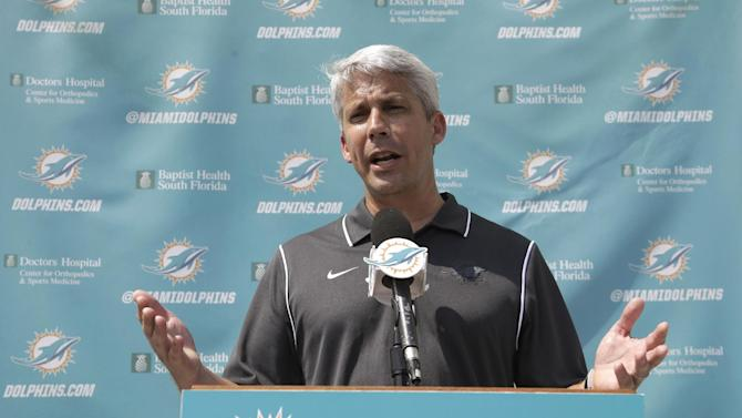 Miami Dolphins general manager Dennis Hickey speaks to reporters after a one-day rookie NFL football minicamp, Friday, May 23, 2014, in Davie, Fla