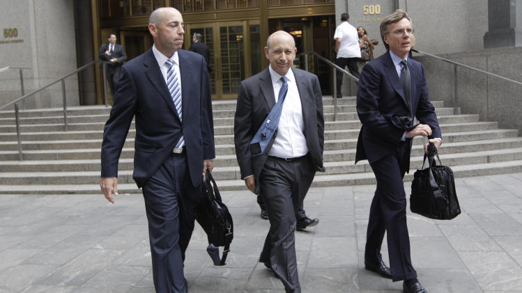 Goldman Sachs chairman and chief executive officer Lloyd Blankfein, center, leaves Federal court, Thursday, June 7, 2012 in New York. Blankfein testified at the New York insider trading trial of a former Goldman board member Rajat Gupta. (AP Photo/Mary Altaffer)