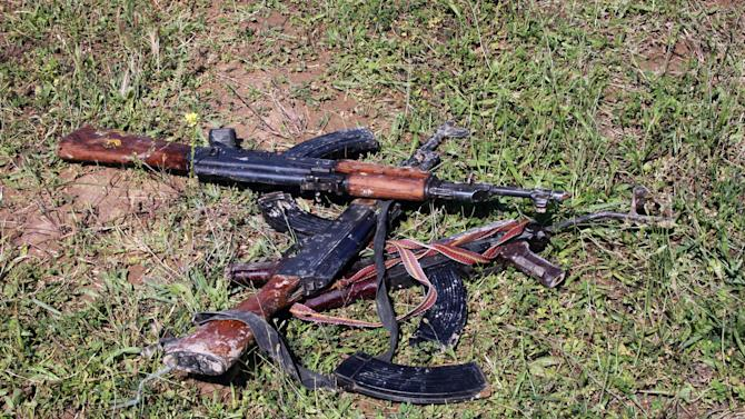 AK-47s seized by Iraqi security forces are seen in Hawija, 150 miles (240 kilometers) north of Baghdad, Iraq, Tuesday, April 23, 2013. Iraqi security forces backed by helicopters raided a Sunni protest camp before dawn Tuesday, prompting clashes that killed scores of people in the area and significantly intensified Sunni anger against the Shiite-led government. (AP Photo)