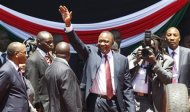 Kenya's President elect Uhuru Kenyatta waves to guests as he arrives for his official swearing-in ceremony at Kasarani Stadium in the capital Nairobi, April 9, 2013. REUTERS/Thomas Mukoya (KENYA - Tags: SOCIETY POLITICS ELECTIONS PROFILE)