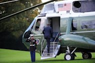 US President Barack Obama boards Marine One from the South Lawn of the White House en route to Camp David, Maryland, on October 19. Obama and Mitt Romney began boning up on foreign policy ahead of their final debate, with the president opting for Camp David's seclusion and Romney jetting to the showdown site in Florida