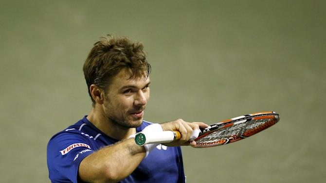 Switzerland's Stan Wawrinka gestures during his men's singles tennis match against Japan's Tatsuma Ito at the Japan Open championships in Tokyo
