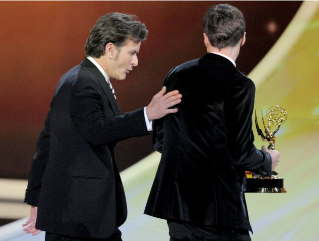 Charlie Sheen, left, is seen with Jim Parsons after presenting him with the award for  outstanding lead actor in a comedy series at the 63rd Primetime Emmy Awards on Sunday, Sept. 18, 2011 in Los Ange