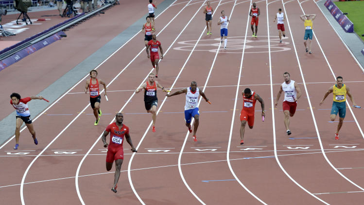 United States' Justin Gatlin crosses the finish line in a men's 4 x 100-meter relay heat during the athletics in the Olympic Stadium at the 2012 Summer Olympics, London, Friday, Aug. 10, 2012. (AP Photo/Martin Meissner)