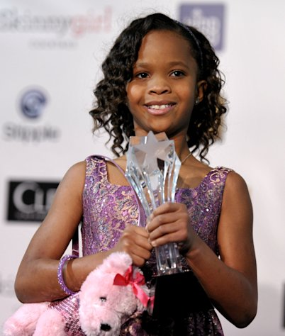 FILE - In this Jan. 10, 2013 file photo, Quvenzhane Wallis is seen backstage with her award for best young actress for &quot;Beasts of the Southern Wild,&quot; at the 18th Annual Critics&#39; Choice Movie Awards at the Barker Hangar in Santa Monica, Calif. Wallis is an actress of talent, poise and maturity well beyond her years. She was 6 when she played the part of Hushpuppy, and at only 9, she is the youngest-ever best actress nominee at the Academy Awards. (Photo by John Shearer/Invision/AP, File)