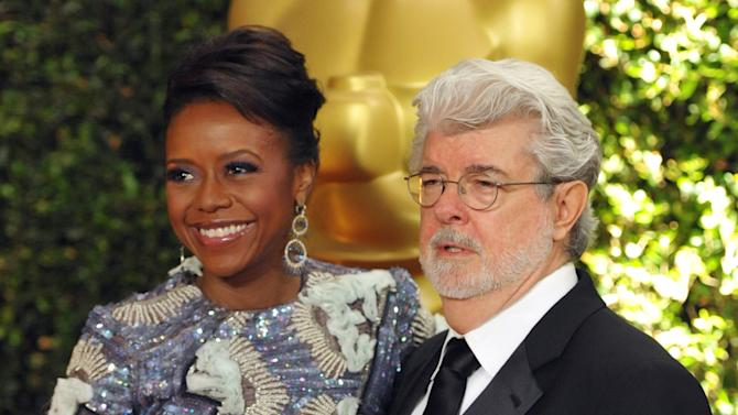 "FILE - In this Nov. 16, 2013 file photo, filmmaker George Lucas and his wife, Chicago native Mellody Hobson, are seen on the red carpet at the 2013 Governors Awards in Los Angeles. Chicago Mayor Rahm Emanuel is trying to persuade the ""Star Wars"" creator to put his planned museum of art and movie memorabilia in Chicago and is offering up a slice of real estate along the Lake Michigan shorefront where it would be located. A competing bid from San Francisco seems a more natural fit: it's Lucas' hometown, it's a premier center of technology and innovation and it's closer to the nation's movie-making heartland. (Photo by John Shearer/Invision/AP)"