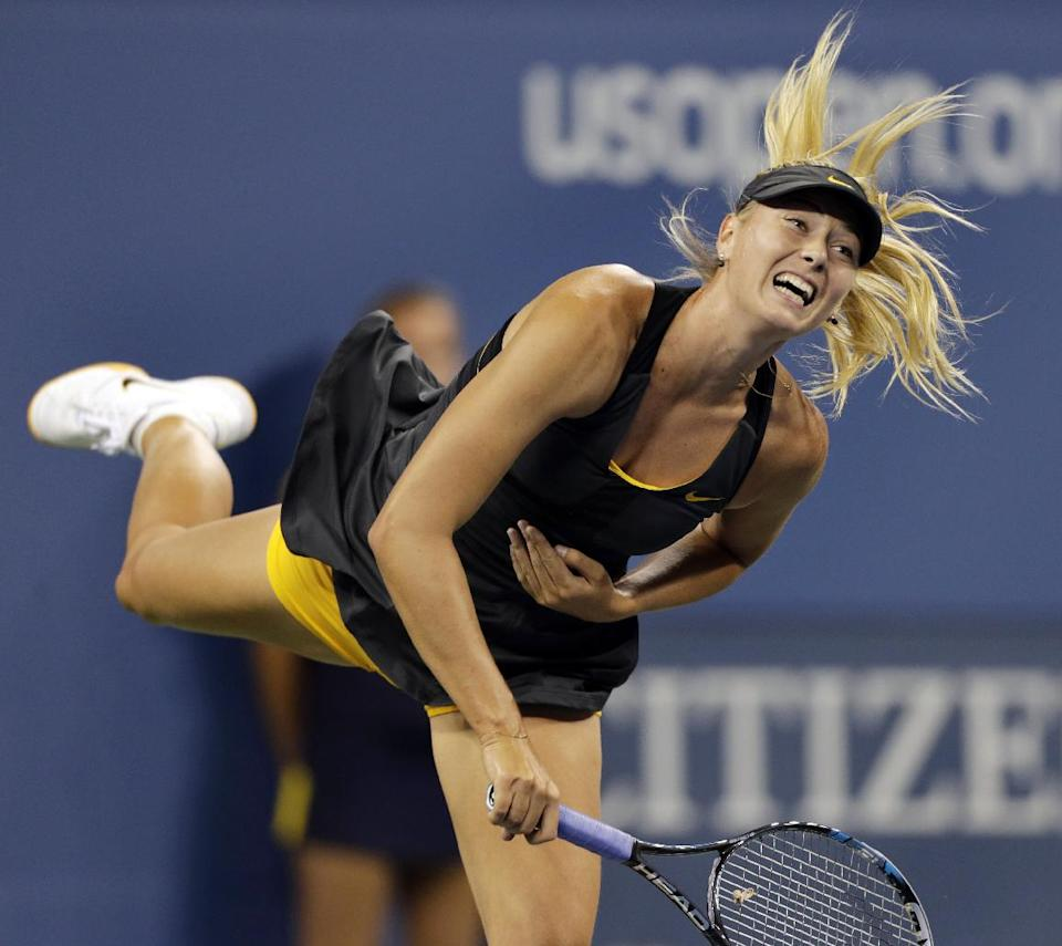 Maria Sharapova, of Russia, serves to Lourdes Dominguez Lino, of Spain, in the second round of play at the U.S. Open tennis tournament on Wednesday, Aug. 29, 2012, in New York. (AP Photo/Charles Krupa)